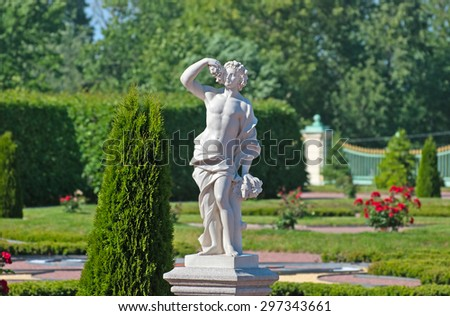 ORANIENBAUM, SAINT-PETERSBURG, RUSSIA - JULY 3, 2015: Autumn Statue. Lower Garden in Oranienbaum Palace and Park Ensemble. It is the State Museum-Preserve and located near Saint-Petersburg - stock photo