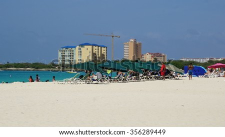 ORANJESTAD, ARUBA - NOV 26: Eagle Beach in Oranjestad, Aruba, as seen on Nov 26, 2015. It has soft white sand and has been rated one of the best beaches in the world. - stock photo