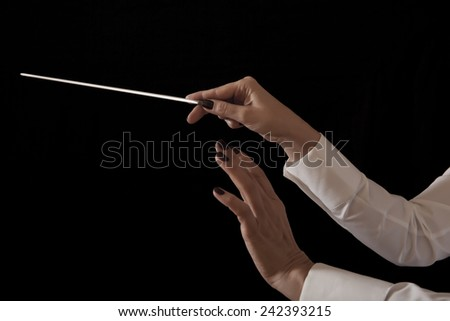 Orchestra conductor hands baton. Music female director holding stick - stock photo