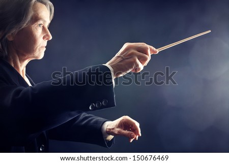 Orchestra conductor music conducting hands with baton