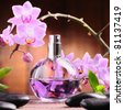 orchid and perfume bottle - stock photo