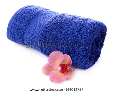 Orchid flower and towel roll, isolated on white