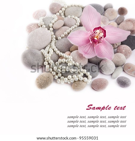 Orchid flower, Spa Stones and pearls over white - stock photo