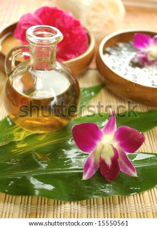 Orchid, massage oil and other spa accessories