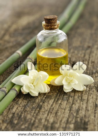 Orchid with bamboo grove, massage oil on old wood background