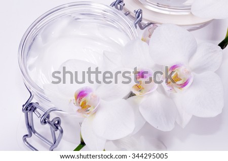 Orchid with cosmetics, cream. - stock photo