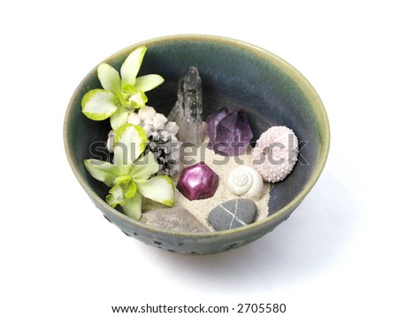 Orchids, Crystals, Shells, and Stones in Handmade Ceramic Bowl - stock photo