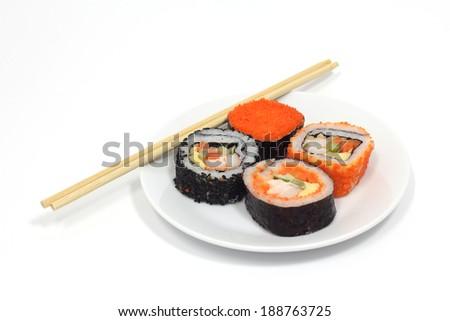 Order sushi on white plate - stock photo