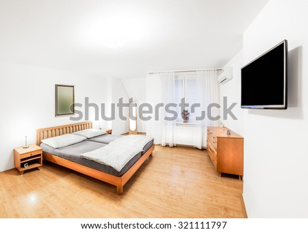 Ordinary Bedroom Of The House In Wooden Style With Double Bed, Bedside  Tables, Mirror