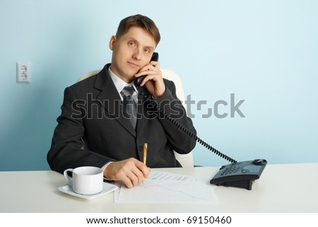 Ordinary official working in the office - talking on the phone - stock photo