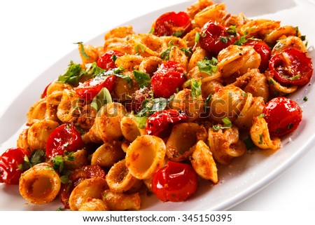 Orecchiette pasta, tomato sauce and vegetables