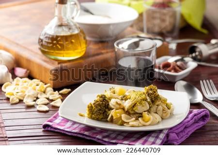 Orecchiette pasta with broccoli and anchovies - stock photo