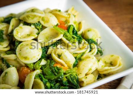 Orecchiette pasta with broccoli rabe and red pepper - stock photo