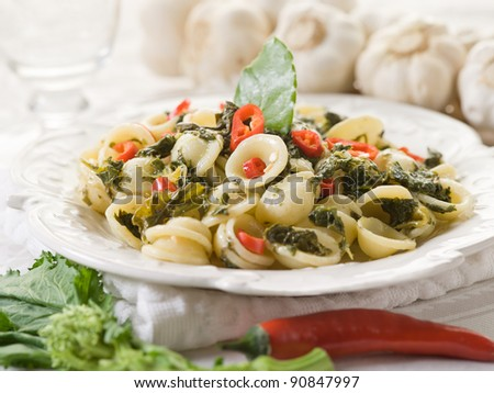 orecchiette with turnip top and hot chili pepper - stock photo