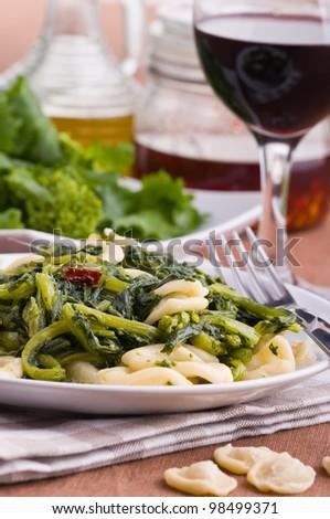 Orecchiette with turnip tops. - stock photo