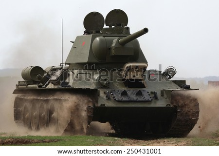ORECHOV, CZECH REPUBLIC - APRIL 27, 2013: Soviet tank T-34 stages an attack during the re-enactment of the Battle at Orechov (1945) near Brno, Czech Republic.  - stock photo