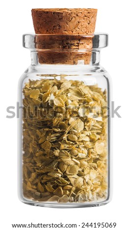 Oregano spice in a little bottle isolated on white background - stock photo