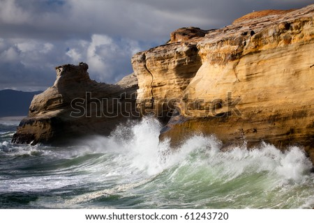 Oregon Coast landscape - beautiful rugged coastline with waves crashing against the cliffs. - stock photo
