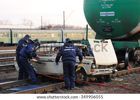 Orel, Russia - December 09, 2015: Emergency Control Ministry (MCHS) tactical exercise. Rescue team saves people stuck in car on rail road - stock photo