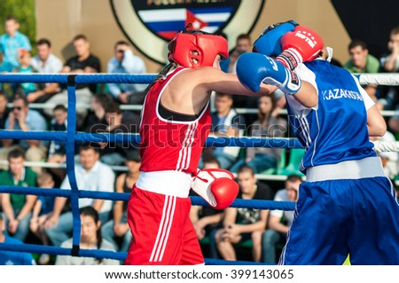 ORENBURG, ORENBURG region, RUSSIA - 25 July 2014: Model boxing match between girls from Russia and Kazakhstan. The match was held at the youth meeting Wednesday between Russia and Cuba  - stock photo