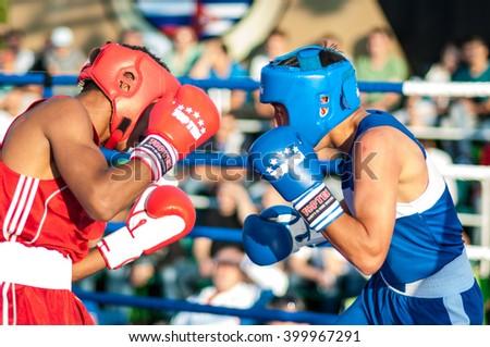 ORENBURG, ORENBURG region, RUSSIA, 25 July, 2014 year. Match meeting Russia on Boxing, Cuba. A boxing match Javier Ibanez, Cuba and Malik Bajtleuov, Russia. Defeated Javier Ibanez - stock photo