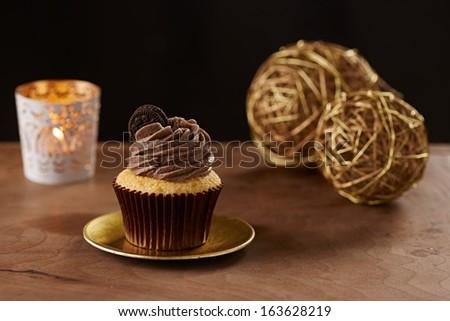 Oreo cookie cupcake on black Christmas background - stock photo