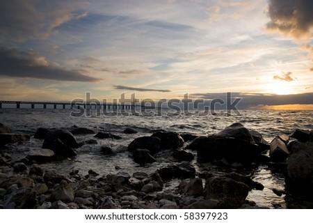 Oresund bridge at sunset - from the swedish side over to Denmark - stock photo