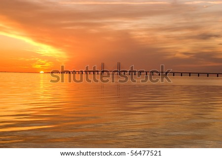 Oresunds bridge at sunset from the swedish side over to Denmark - stock photo