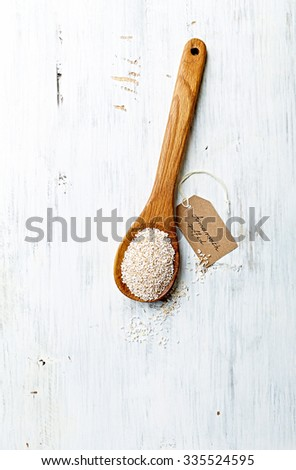 Organic amaranth on a wooden spoon (puffed) - stock photo