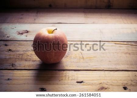 organic apple on wooden - stock photo