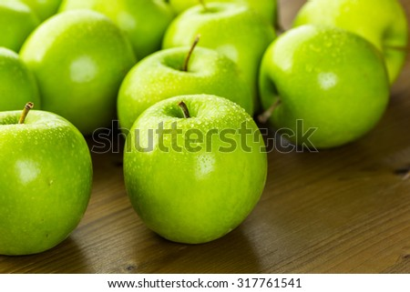 Organic apples fresh from the farm on wood table. - stock photo