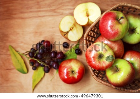 organic apples in a basket on a wooden table