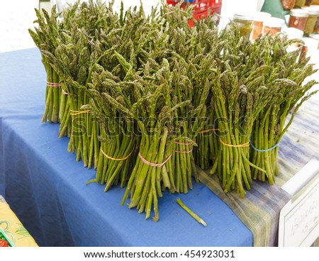 Organic asparagus for sale at farmers market - stock photo