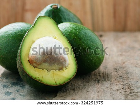 organic avocado with space on old wooden table.Healthy diet concept. - stock photo