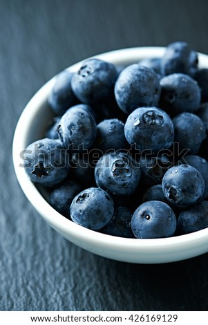 Organic Blueberries in a Ceramic Dish - stock photo