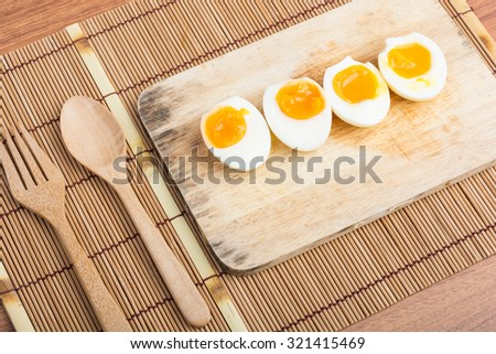 Organic Boiled Eggs Ready to Eat on wooden background - stock photo