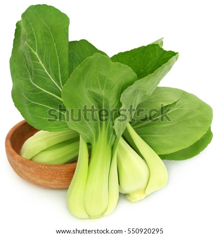 Organic Bok Choy in a wooden bowl over white background