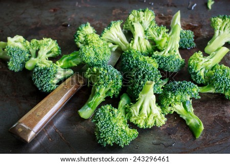 Organic broccoli fresh from garden cutting prepare for cook on old tray - stock photo