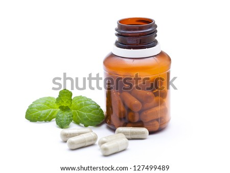 Organic capsule with mint leaves. - stock photo