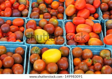 organic cherry tomatoes in bucket at market