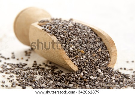 organic chia seed on a wooden shovel - stock photo