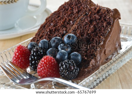 Organic chocolate cake with fresh berries - stock photo