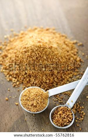Organic coconut palm sugar in measuring spoons - stock photo