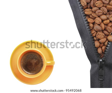 organic  coffee beans in a cup of orange