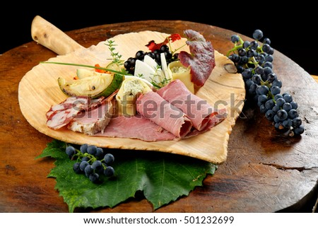 Organic cold cut on the wooden table