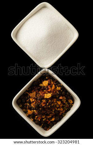 organic color pepper seasoning and salt in white bowls