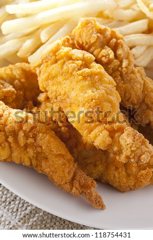 Organic Crispy Chicken Strips on a background - stock photo