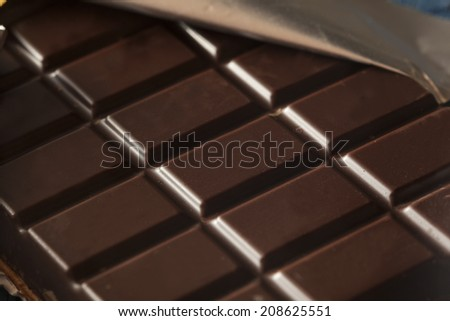 Organic Dark Chocolate Candy Bar in a Wrapper - stock photo