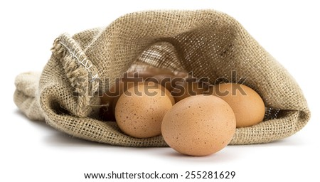 Organic eggs in jute sack isolated on white background. - stock photo