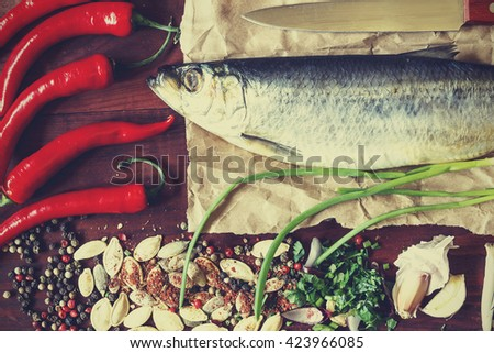 organic food ,frame of food ingredients and fish in the center. Frame of useful food, space for text. View from above - stock photo